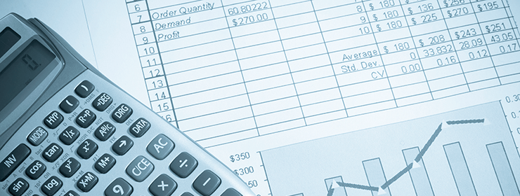 Accountant Mississauga - Calculator and balance sheet