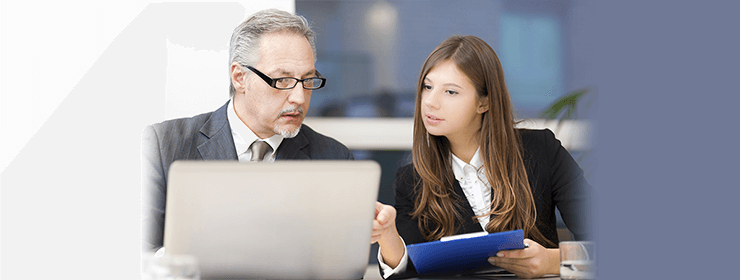 Accountant Mississauga - Old man and Young woman having a business discussion